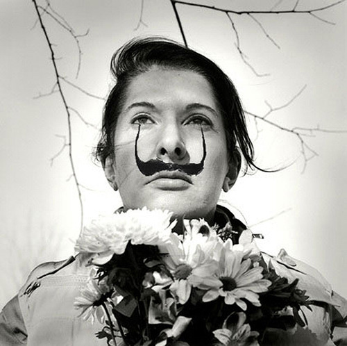 in honor of dali's 108th birthday, marina abramovic tries on his mustache .