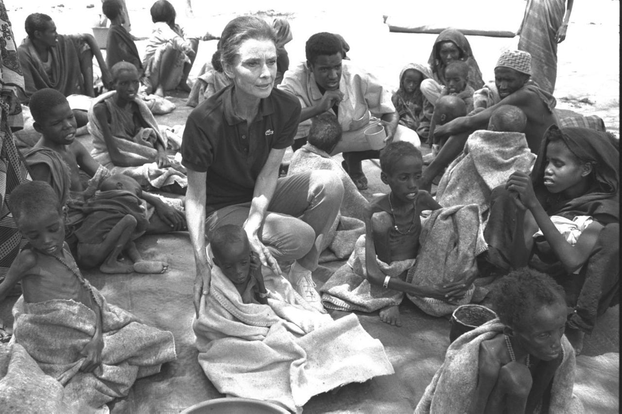 unicef:  UNICEF Goodwill Ambassador Audrey Hepburn sits amidst severely malnourished children at a UNICEF-assisted feeding centre in the town of Baidoa, Somalia. Ms. Hepburn completed a four day tour of Somalia and northern Kenya on 24 September, 1992 - visiting UNICEF-assisted feeding centres and primary health care facilities in Mogadiscio, Kismayo, and Baidoa - to bring world attention to the plight of children and women there. © UNICEF/NYHQ1992-1171/Betty Press Currently, there are over 1 million children in Central and West Africa facing a nutrition crisis similar to what Ms. Hepburn witnessed in 1992. To learn more and to see how you can get involved, please visit: http://www.unicef.org