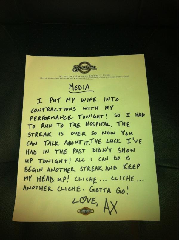 Milwaukee Brewers closer John Axford leaves a note for the media.