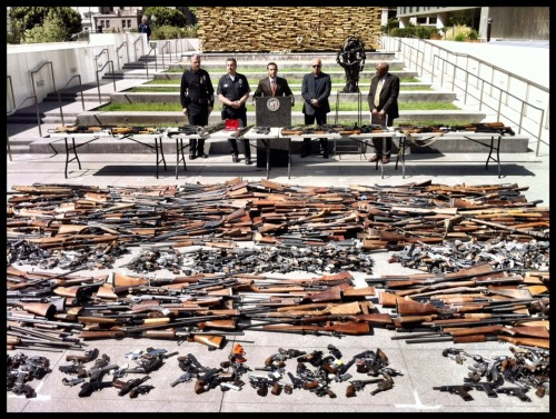 lamayor:  1,673 firearms were collected this weekend for the 2012 Gun Buyback program, spearheaded by the Mayor's Office of Gang Reduction & Youth Development (GRYD) and LAPD. Thank you to the Angelenos who turned in a firearm and helped us secure a safer City for everyone.  Guns organized (relatively) neatly.