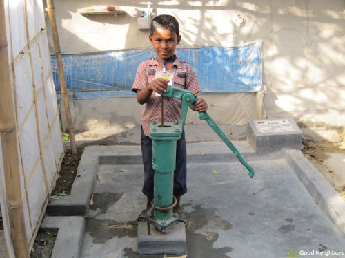 A young boy enjoys the brand-new, clean water pump Good Neighbors Bangladesh built for his community in Kalai. Now everyone in the area has access to safe drinking water.Learn how to help us bring clean water to even more people.