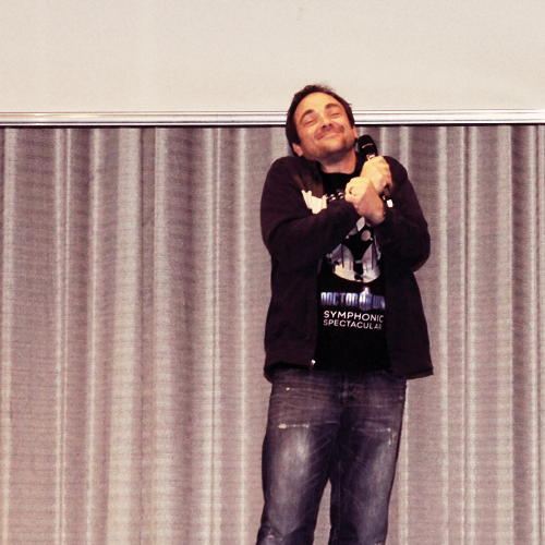 Mark Sheppard hugging the audience.