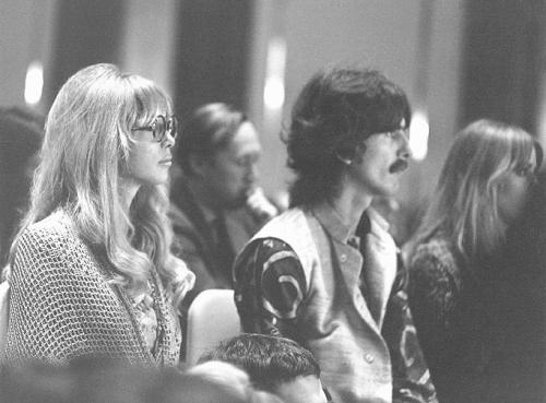 Meditation Lecture in London  Thursday August 24, 1967 - The Beatles and wives plus Jane Asher, Jenny Boyd and Mike McCartney (minus Ringo, who was with Maureen at the hospital taking pictures of five-day-old son Jason!) attended a Transcendental Meditation lecture at the London Hilton Hotel and met Maharishi Mahesh Yogi. Pattie had become interested in meditation months earlier and encouraged George and the others to attend. Pattie & George with Jenny (partially obscured) sitting in the front row of the Hilton ballroom during Maharishi's lecture. Scan from the Something About Pattie Boyd group at Yahoo!