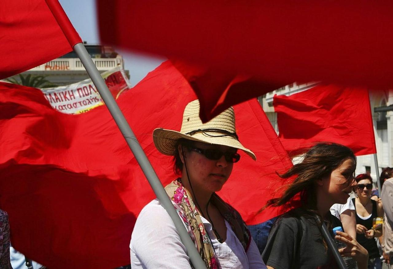 Students and workers carry red flags during a May Day protest in central Athens May 1, 2012. Thousands of workers across southern Europe protested against spending cuts in annual May Day rallies on Tuesday, before weekend elections in Greece and France where voters are expected to punish leaders for austerity. Reuters