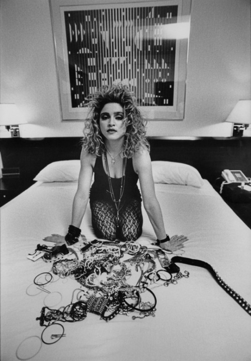 "It's 1986. You are alone with Madonna in a hotel room. She says ""Hang on a sec and let me take a few of these bracelets off."" You order room service. You eat room service.You check out what's on Cinemax. She's almost got everything off …….."
