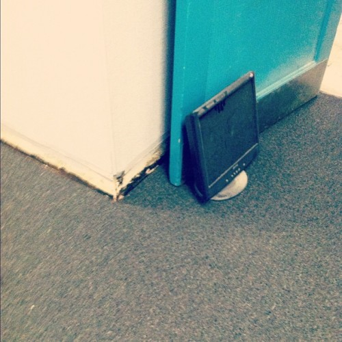 Computer monitor as a door stop. Only at my job. (Taken with instagram)