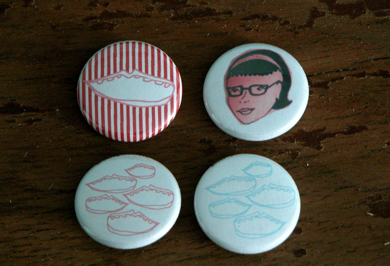Give-away buttons I designed to match the new look of the shoppy shop!