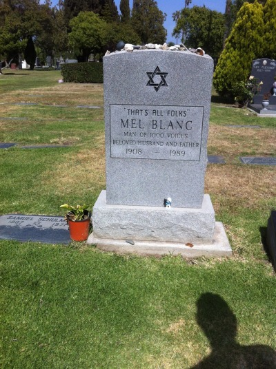 "Mel Blanc was an American voice actor and comedian. He was best known for his work as a cornucopia of characters from classic Warner Bros. cartoons, such as Bugs Bunny, Daffy Duck, Porky Pig, Sylvester, and many, many more.   Blanc died on July 10, 1989 at Cedars-Sinai Medical Center in Los Angeles, California. As part of Bugs Bunny's 50th anniversary, Mel Blanc had filmed an Oldsmobile commercial with his son, Noel Blanc. At the end of shooting, Noel noticed that his dad had a heavy cough. They drove to the doctor, who said that Mel could either stay in the hospital overnight, ""just to be safe"", or that they could bring an inhaler home. Mel Blanc chose the former, and while at the hospital, due to the fact that someone had forgot to put bed rails on his hospital bed, he fell out of bed and broke his hip, which released fat emboli into his brain, causing a stroke. He had died within 48 hours.  - Mel Blanc's Wikipedia Article"
