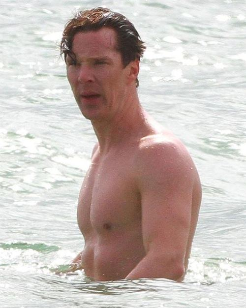 lornasp:  Mr Cumber Butch Sherlock star shows  off toned physique  IF you want to know why Sherlock's Benedict Cumberbatch is The Sun's Sexiest Man, here's a big clue. Benedict, 35, showed off his toned physique as he relaxed in the sea in Los Angeles. He also played games on the beach with pals — sporting bird-print shorts and shades. Benedict was voted No1 by readers ahead of David Beckham and TOWIE's Joey Essex — even though the modest star reckons he looks like a racehorse.