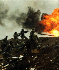 simply-war:  Iranian soldiers in the battlefield firing towards Iraqi soldiers.