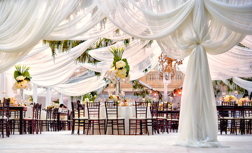 pumps-pearls:  Drapery can always add a soft touch to your event space