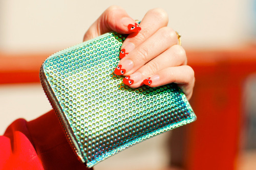 powderdoom:  peoplewithstyles:  Comme des Garcons Zip pouch  The nails! Details are the best.