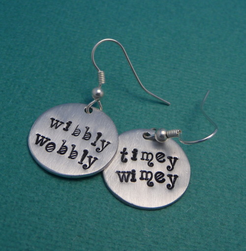 "chasingatstarlight:  Doctor Who Inspired - Wibbly Wobbly Timey Wimey - A Pair of Hand Stamped Earrings A pair of Aluminum disc earrings stamped with ""Wibbly Wobbly"" & ""Timey Wimey"" the words of the Tenth Doctor as he attempts to explain Time Travel. Stamped here in my Wonderland lowercase font. A great gift for any pair of Doctor Who fans! For that and other Doctor Who related items please check out my Etsy shop!"