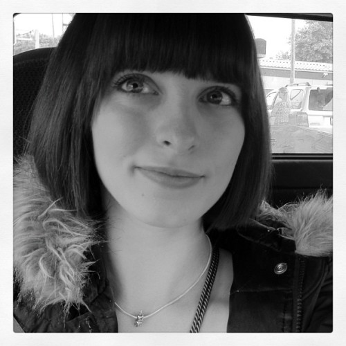 Enjoying my new #haircut .  #brunette #bob #blueeyes #fauxfur #smirk #bangs (Taken with instagram)
