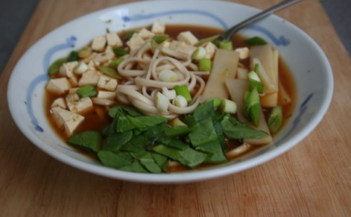 UDON MISO SOUP BOWL This is a really simple miso soup that you can make in about 5 minutes. Boil up some wholewheat udon noodles according to pack instructions. Make up one cup of miso soup per person and pour into a bowl (I use 1 Tbs miso paste per cup of boiling water but a sachet will work fine too). Place the noodles into the soup and add cubed tofu, a sliced spring onion, some bamboo shoots and spinach. Yummy :)