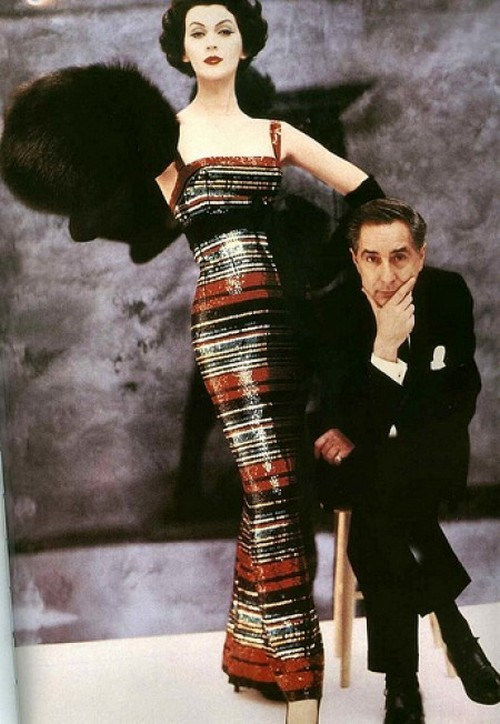 theniftyfifties:  Designer Norman Norell and Dovima wearing the Roman striped version of his famous sequinned evening gown, 1956. Photo by William Helburn.  Designer Norman Norell and Dovima wearing the Roman striped version of his famous sequinned evening gown, 1956. Photo by William Helburn.