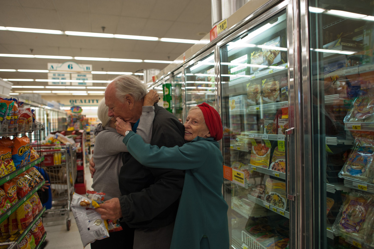 timelightbox:  Jeanie, Will and Adina at the supermarket, 2011 — Isadora Kosofsky Meet Jeanie, 82, Will, 84, and Adina, 90— the three are bound together in a relationship, you could call it a love triangle of sorts. 18 year old photographer Isadora Kosofsky documents their relationship — read more about it here.  This is a great photo essay.