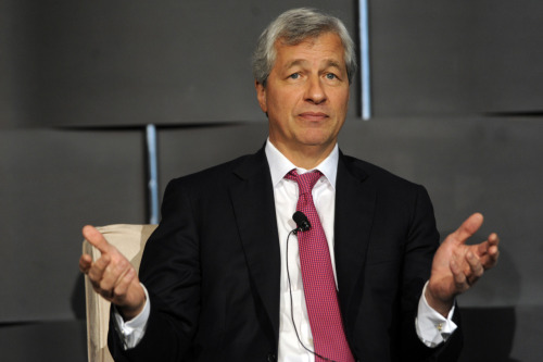 reuters:  Shareholders in JPMorgan Chase & Co on Tuesday rejected a proposal calling on the company to split the roles of chairman and chief executive, a victory for incumbent Jamie Dimon. The proposal received some 40.1 percent of votes cast in favor, the company said at the end of its annual meeting. DEVELOPING: JPMorgan shareholders reject chairman/CEO split  This guy hasn't had a good week.