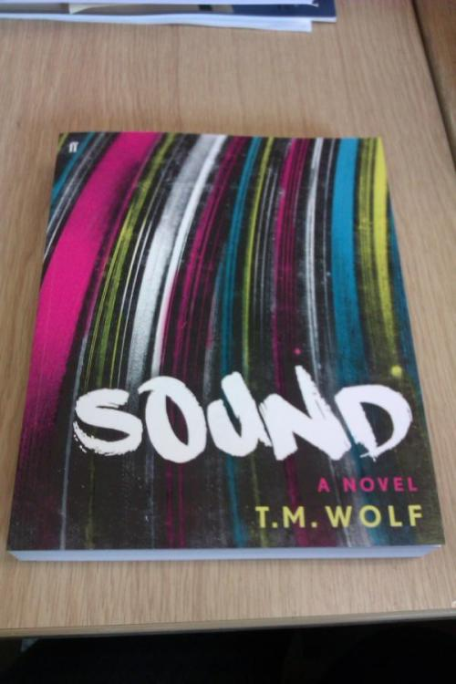 "As seen on T.M. Wolf's Facebook page, the UK edition of Sound. You can see the full US cover art on T.M. Wolf's Tumblr… or tantalize yourself with the spine, as featured in NYT's ""Bookshelf"":    ""The formalist games continue with Sound (Faber & Faber, $18), by the hip-hop fanatic and Yale Law School grad T. M. Wolf, who also has degrees in intellectual history and urban planning. His dizzying interests somehow coalesce in this first novel, with the prose arranged here and there on horizontal lines, like musical notation."""