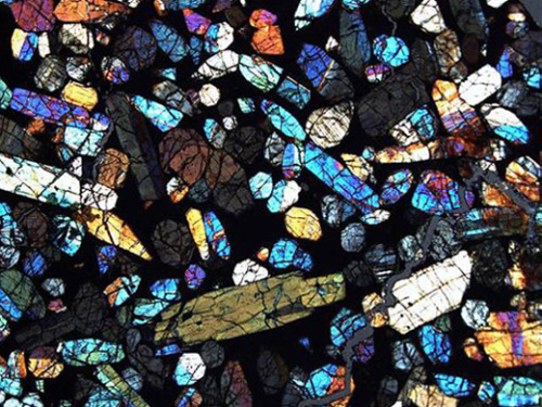blamoscience:  This is a thin section of a meteorite from the Miller Range, Antarctica. Field researchers in Antarctica have returned with more than 17,500 meteorites over the 30-plus years that the extraterrestrial material has been collected from the frozen continent. Yet meteorite science is still in its infancy, and the collected rocks still hold plenty of surprises that could shape our understanding of the solar system, according to scientists involved in the search and characterization of the Antarctic meteorite collection.