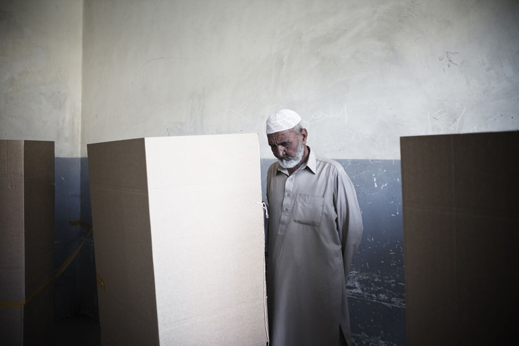 An elderly man at a polling center. The presidential elections in 2009 saw 41 candidates competing for votes at 6,000 polling stations protected by some hundreds-of-thousands of Afghan and foreign troops around the country. They were still widely seen as being corrupt. Another election is set for 2014, just as foreign troops will be pulling out. Photo: Sandra Calligaro The war in Afghanistan is not over. Help us tell the story. Fund our Kickstarter.