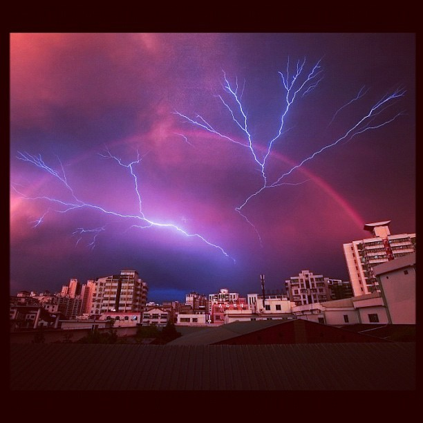Lightning strikes to a rainbow backdrop in Haikou, China (Taken with instagram) More here: http://huff.to/JFmZrs