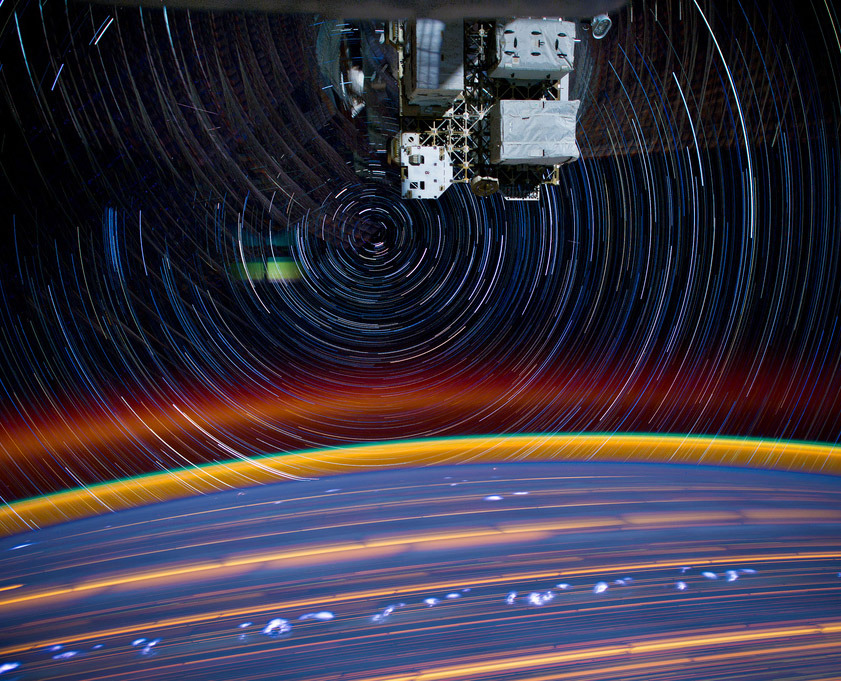"(via Psychedelic Star Trails and City Lights From Orbit: Big Pic : Discovery News) ""Streaks of psychedelic colors show the passage of cities below the International Space Station (ISS), airglow in Earth's atmosphere and the circling motion of stars in this stunning new image from Expedition 31 Flight Engineer Don Pettit. Pettit created the image by combining 18 long-exposure digital images taken with a camera mounted inside the ISS on March 16, 2012. Because of the limitations of digital imaging sensors, multiple exposures are needed to get such an image.  ""My star trail images are made by taking a time exposure of about 10 to 15 minutes,"" said Pettit. ""However, with modern digital cameras, 30 seconds is about the longest exposure possible, due to electronic detector noise effectively snowing out the image. To achieve the longer exposures I do what many amateur astronomers do: I take multiple 30-second exposures, then 'stack' them using imaging software, thus producing the longer exposure.""  The bright blotches lined up at the lower portion of the image are lightning flashes within storm clouds."" I'm in love with this photograph."