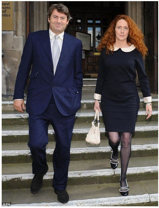 Bag's Take-Away: Part de Milo, part Sunnybrook Farm. Rebekah Brooks gets the BagNews Treatment. See the rest of the rogues who made this week's gallery at BagNews.  (credit:PA caption: Mrs Brooks and her racehorse trainer husband Charlie Brooks leave High Court in London today after the former News International boss gave evidence.) Visit BagNewsNotes: Today's Media Images Analyzed ————— Topping LIFE.com's 2011 Best Photo Blogs — also follow us on Twitter and Facebook.