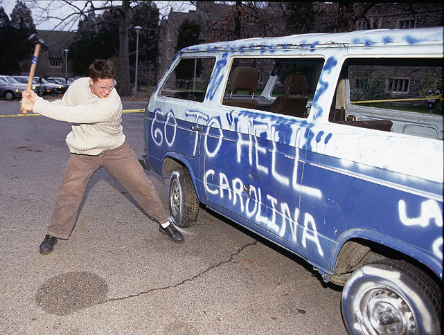 A Duke fan takes a baseball bat to a painted van before a 1998 game between the Tar Heels and Blue Devils (Bob Donnan/SI) GALLERY: Duke-North Carolina Classic Photos