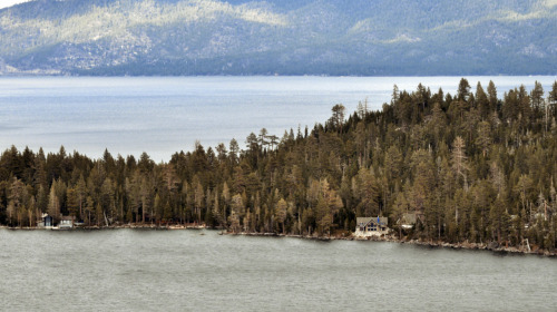 I was hiking around a smaller lake next to Lake Tahoe and I saw these houses on the shoreline.  I think I want to live here.  I took this shot from above the Cascade Falls. Photographer: Steven WilliamsLocation: Lake Tahoe, CADate: May 3, 2012steveslefteye.comfacebook.com/steveslefteyefacebook.com/isstevestillalive@stevestillalive #tahoe #lake #cascade #house #outdoors #waterfall