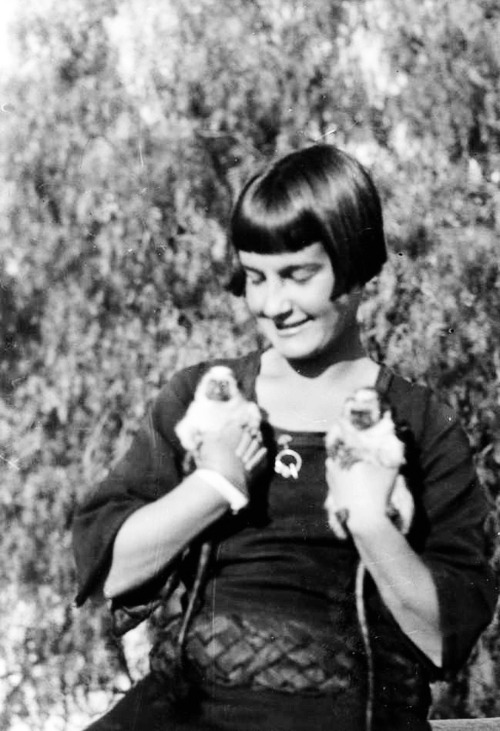 Woman with pet monkeys c. 1920's