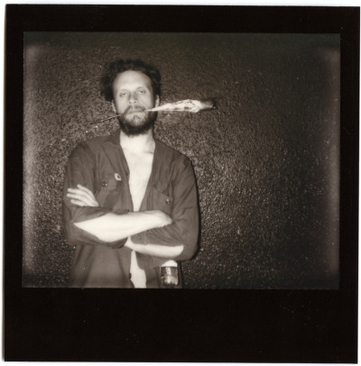 Father John Misty in the midst of a blink… or really stoned ;) Horseshoe Tavern, Toronto. May 14th 2012. (shooting in the dark, boo. w/ Impossible Film for Spectra Polaroid)