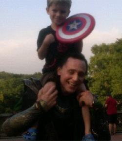 "Fudging adorable. These guys… <3  Story of a Five Year-Old Avenger, Meeting the Avengers ""Hi, Loki!"" my wife said (100% sure she didn't know Tom Hiddleston's name). ""Can my son get a picture with you?"" she asked. ""Can I put him on my shoulders?"" Loki asks. ""Um … okay?"" is Jill's response and hands Tom Hiddleston our son.  He hoists him up on to his shoulders (I should mention that this guy is like 8 feet tall), and my wife takes out her Blackberry, only to find that it's on its last battery leg. Nonetheless she manages to get a couple of shots.  Hiddleston puts Edison down, shakes his hand and says goodbye… … Evans crouches down next to Edison, who extends his hand and shakes the hand of The First Avenger. ""Can I see your shield?"" Evans asks and Edison hands his battered toy shield over. ""Wow, you're getting a lot of use out of this. You fighting a lot of bad guys with this?"" he asks.  Chris Evans and Edison proceed to have a conversation about the finer points of shields and fighting the enemy.  Submitted by nessastooshort"