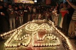 Palestinians gather around candles lit ahead of Nakba, in the West Bank city of Ramallah May 14, 2012. On May 15 Palestinians will mark Nakba, or catastrophe, of Israel's founding in a 1948 war, when hundreds of thousands of their brethren fled or were forced to leave their homes. (REUTERS/Ammar Awad)