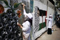 Palestinian artists paint murals marking Nakba in Gaza City May 15, 2012. Palestinians mark Nakba, or catastrophe, of Israel's founding in a 1948 war, when hundreds of thousands of their brethren fled or were forced to leave their homes. (REUTERS/Suhaib Salem)