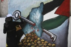 "A Palestinian woman paints a mural during the 64th anniversary of ""Nakba"", Arabic for catastrophe, the term used to mark the events leading to Israel's founding in 1948, in Gaza City, Tuesday, May 15, 2012. Hundreds of thousands of Palestinians fled or were forced from their villages during the war over Israel's 1948 creation, an event they commemorate every year as their ""Nakba"". (AP Photo/Hatem Moussa)"