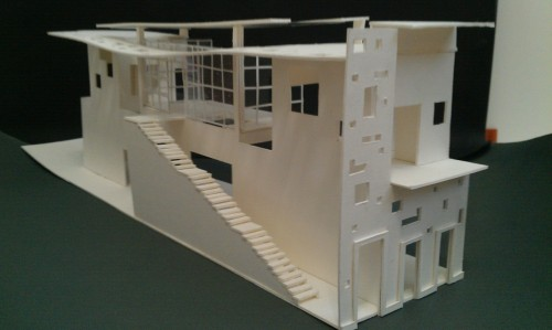 This is my model for a San Juan-style house. It is 110 feet by 23.5 feet and 33.5 feet tall up front, 30 feet tall in the middle. It was designed for an artist. This summer I'll pass it on to the computer, so you can expect it to look more…real.