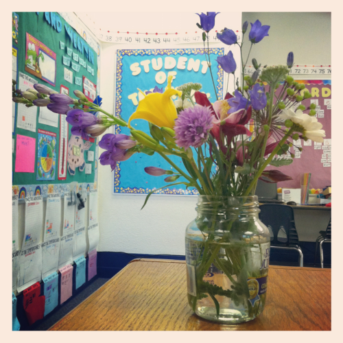 Hand picked flowers in a fancy grey poupon jar from a six year old boy. Life is good.