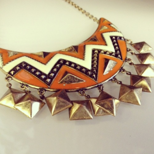 Love, love, love our new boho collar necklace.  With studs for dangle-magic, and a fun pop of orange, this necklace is definitely perfect for summer. Only $28 at our shop!