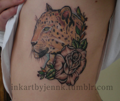 leopard on ribs. ouch! Tattoo by: Jenn Kakoyannis 2012 Rebel Image Tattoo, Rio Grande NJ
