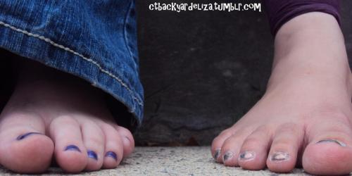 "Eliza kept tickling me with her toes :P  ctbackyardgirls:  More photo's from Eliza (silvery nails) and Vanessa's (blue nails) ""footoshoot"""