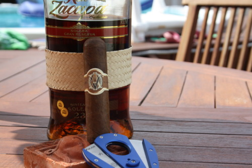 Sunday afternoon…poolside…Avo Heritage short robusto…23 yr old..zacapa rum…cigar nothing to write home about…but the rum was splendid! Source: Zacapatista (2012)