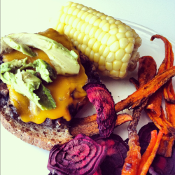 Eating rainbows for dinner.  Homemade black bean cheese burger with roasted orange peppers and avocado, corn on the cob, and I also tried my hand at homemade beet and carrot chips (80% success on those).