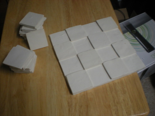 The fruit of today's labor; 32 tiles to serve as white squares, and 1/4th of the board complete