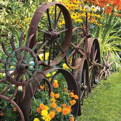 Another idea for the garden-related repurposing file: Old metal wheels — look for them at flea markets — wired together to make edging for a planting bed. (via This Old House)