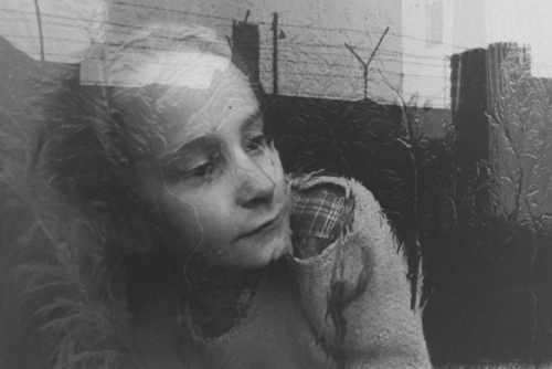 """A girl looks at the Berlin Wall through a frosty window which reflects the Wall's silhouetted barbed wire in December 1962."" (Paul Schutzer—Time & Life Pictures/Getty Images)"