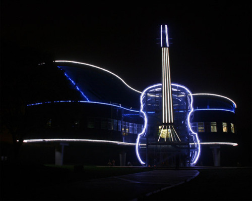 "The Piano House, located the city of Huainan, An Hui Province in China  ""This Amazing Piano House designed by the students of the architectural design faculty of Hefey University of Technology with the designers of the company ""Huainan Fangkai Decoration Project Co"". It resides in located in Huainan City, a Province, China. The building was constructed for music lovers, and serves a practice facility for musical student at the nearby college.Piano house consist of two musical instruments a transparent Violin leaning against Piano. The Piano House was built by the local government to draw interest to the newly developed area. ""  [viaCube Me]"