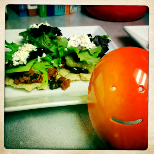 Happy Spoon likes to make Chorizo Sopes with Fresh Tomatillo Salsa. Recipe (featured in Authentic Mexican by Rick Bayless): 2 1/4 cups instant masa flour mix, mixed with 1.5 cups hot water, covered, and left to stand for 20 min 2 Tbsp vegetable shortening 1/3 cup flour (+ 1 Tbsp for masa) 3/4 tsp salt 1 tsp baking powder small can of black beans, juices retained 12 oz soyrizo (I use soyrizo instead of chorizo, for the health benefits!) vegetable oil for frying 1/2 cup crumbled Mexican cheese (I like cotija) lettuce (optional) Tomatillo Salsa: 8 oz tomatillos, husked, stemmed, and washed 2 serrano chiles (SPICY! you can use less spicy chiles if you wish, like jalapenos or even mild green chiles like pasillas or Anaheim peppers) 6 sprigs of fresh cilantro (aka coriander) 1/2 small yellow onion 1/2 tsp salt  Directions: Salsa: Boil the tomatillos in salted water for ~9 min until barely tender, then drain. Add all the ingredients to a food processor or blender; coarsely puree. Let stand for ~30 min to allow the flavors to blend. Salsa time!  (you can eat this by itself with chips, or serve on tops of your sopes!) Sopes: With the moistened masa mix, add shortening, flour, salt, and baking powder.  I used a pastry blender to thoroughly mix in the shortening, similar to making a pie crust from scratch.  After ingredients are mixed, knead until the consistency allows you to form dough balls.  If you need to, add 1 Tbsp of water at a time to moisten the dough and adjust consistency.  Divide the dough into ~12 balls, covering with plastic wrap when not in use.  Flatten each ball into a small disc, ~2.5 inch in diameter. Heat a skillet over medium heat, and cook each masa disc about 2 min on each side, until lightly browned. Cut each masa disc in half like a hamburger bun, keeping them covered in plastic wrap when not being used.  You are supposed to form ridges around the edges of the masa discs to hold toppings, but I didn't do this because it was too much work. Start cooking the toppings.  Put the beans in a small saucepan with their juices and heat, covered, until warmed and juices thickened into a beany broth. Cook the soyrizo in a small skillet with 1 Tbsp oil over medium-low heat until crispy (for real chorizo, you'll need to drain the fat afterwards); cover to keep warm. Fry the masa discs!  Heat ~3/4 in oil in a skillet (to ~360 °F).  Fry each masa disc ~3-4 min until lightly browned and lightly crispy.  Drain on paper towels and keep warm in a low oven. Assemble the sopes!  These are kind of like mini tostadas; masa disc on the bottom, scoop a Tbsp or so each of beans, chorizo, and tomatillo salsa.  You can put lettuce on it too, but I decided that this was too messy and didn't add much to the overall dish.  Top with crumbly Mexican cheese, like cotija or queso fresco. Eat them up, yum!  Fun Fact: These are supposed to be appetizers according to Rick Bayless…but I definitely ate them as a meal.