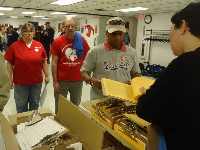 Pic from WI AFL CIO-people picking up walking packets. 5/11