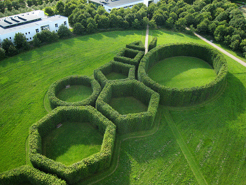 The Geometrical Gardens by C.Th. Sørensen The hedges are controlled by a simple geometrical set of rules. For every new 'room' the visitor enters, the 'room' is added a new side.
